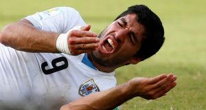 Uruguay's Luis Suarez reacts after clashing with Italy's Giorgio Chiellini during their 2014 World Cup Group D soccer match at the Dunas arena in Natal. Photograph: Reuters