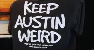 A 'Keep Austin Weird' T-shirt on Congress Street. Photograph: Getty