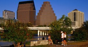 Relaxing in Butler Park East in downtown Austin. Photograph: Getty
