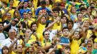 Fans take pictures at the 2014 World Cup Group A soccer match between Cameroon and Brazil at the Brasilia national stadium in Brasilia June 23, 2014. Photograph: Dominic Ebenbichler/Reuters