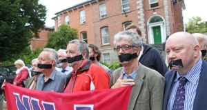 Outside the Egyptian Embassy in Dublin yesterday, members of the NUJ including Irish Secretary Seamus Dooley (right) protested against Egypt's jailing of three al-Jazeera journalists. Photograph: Julien Behal/Maxwells