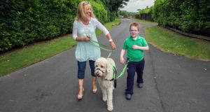 Eleanor Bermingham with her son Mikey and their dog Ralf  near their home in Citywest Dublin. Photograph: Brenda Fitzsimons