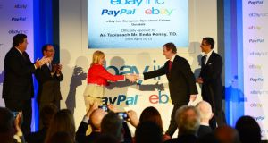 PayPal launch: Louise Phelan, PayPal's vice president of global operations for Europe, Middle East and Africa, shakes hands with Taoiseach Enda Kenny at the recent official opening of the International Operations centre of eBay in Dundalk which includes PayPal and eBay. Photograph: Alan Betson