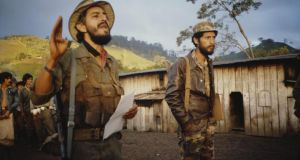 Sandinistas address workers on a state coffee plantation in 1986. Photograph: Scott Wallace/Getty Images