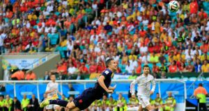 Netherlands' Robin van Persie scores a sublime goal during the match against Spain. The Dutch striker returns from suspension for the last-16 tie with Mexico. Photograph: AP/Bernat Armangue