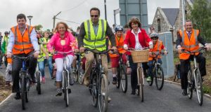 Leo Varadkar, backed up  Joan Burton  takes to his wheels on a new cycleway. Photograph: Brenda Fitzsimons