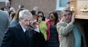 One of the Birmingham Six, Paddy Hill wipes a tear as the coffin of Gerry Conlon is carried into St. Peter's Cathedral for his funeral Mass in Belfast today. Photograph:  Charles McQuillan/Getty Images