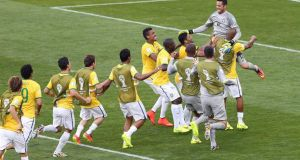 Brazil's players celebrate after winning the penalty shoot against  Chile at the  Mineirao Stadium in Belo Horizonte. Photograph: EPA