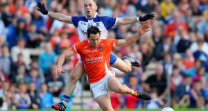 Monaghan's Stephen Gollogly in action against Armagh's Aaron Kernan during the Ulster SFC semi-final at Clones. Photo: Cathal Noonan/Inpho
