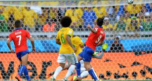 Mauricio Pinilla (right) of Chile rattles the crossbar in the closing stages of extra-time in their second round match against Brazil   in Belo Horizonte.