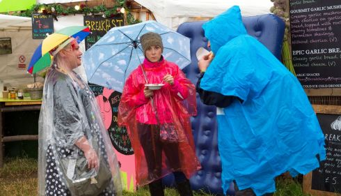 Oh no! Not another wet Glastonbury! There's hope for sunshine, but these punters are ready for the worst. Photograph: Matt Crossick/PA Wire