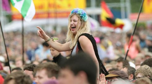 A member of the crowd enjoys Blondie performing on the Other Stage at the Glastonbury Festival 2014. Photograph: Yui Mok/PA Wire