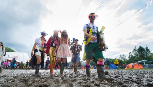 A little sunshine rewards festivalgoers for their efforts wading through fields of mud on Sunday. Photograph: Matt Crossick/PA Wire