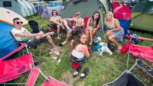 Festival goers relax by their tents. They look clean now, but give them four days and see how they are. Photograph: Ian Gavan/Getty Images