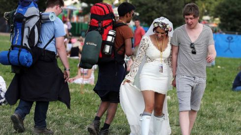 Newlyweds Bianca and Jack Vaughan arrive at Worthy Farm. The white wellies are cute. Photograph: Cathal McNaughton/Reuters