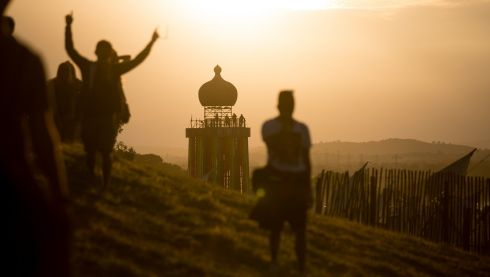 People gather to watch the sun set at Glastonbury, where the festival is now in its 44th year. Photograph: Matt Cardy/Getty Images
