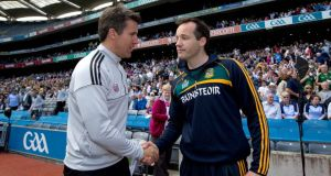 Kildare manager Jason Ryan and Meath  manager Mick O'Dowd shake hands after the Leinster football senior championship semi-final in Croke Park yesterday. Photograph: Inpho/Ryan Byrne