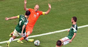 Arjen Robben of the Netherlands (C) is fouled  by Rafael Marquez of Mexico  at the Estadio Castelao in Fortaleza. Photograph: EPA