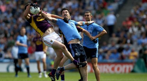 Dublin's Michael Darragh Macauley and Daithi Waters of Wexford in action during the Leinster GAA Football Senior Championship Semi-Final 2014, Croke Park, Dublin. Photograph: Ryan Byrne/Inpho