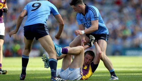 Dublin's Cian O'Sullivan and Philly McMahon up against Tiarnan Rossitor of Wexford in the Leinster GAA Football Senior Championship Semi-Final, Croke Park, Dublin. Photograph: Ryan Byrne/Inpho