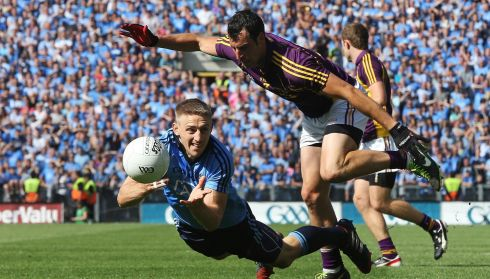 Dublin's Eoghan O'Gara and Graeme Molloy of Wexford in the Leinster GAA Football Senior Championship Semi-Final, Croke Park. Photograph: Cathal Noonan/Inpho