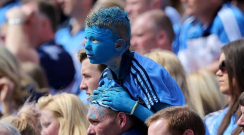 A young Dublin supporter looks on from Hill 16 during the Leinster GAA Football Senior Championship Semi-Final, Croke Park. Photograph: Donall Farmer/Inpho