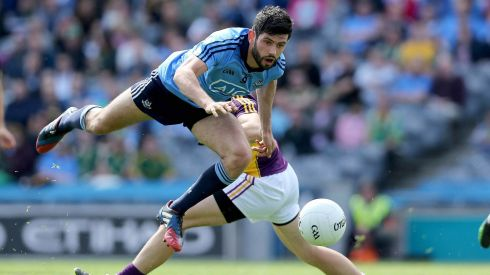 Graeme Molloy of Wexford with Cian O'Sullivan of Dublin (front) in the Leinster GAA Football Senior Championship Semi-Final, Croke Park. Photograph: Donall Farmer/Inpho
