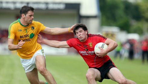 Down's Niall Madine in action with Leitrim's Donal Wrynn. Photograph: Matt Mackey/Inpho