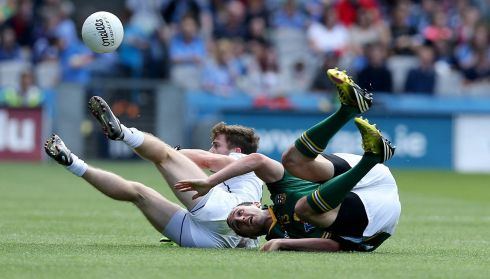 Kildare's Niall Kelly with Kevin Reilly of Meath.  Photograph: Donall Farmer/Inpho