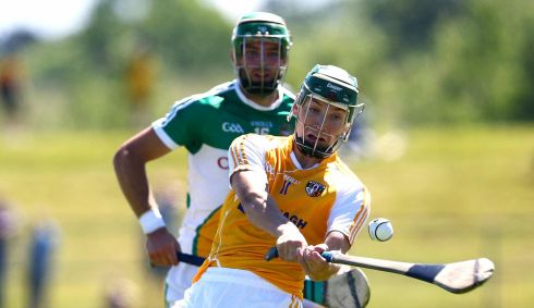 Antrim's Paul Shiels with Offaly's Joe Bergin in the Hurling All Ireland Senior Championship Round 1, Ballycastle, Co Antrim.  Photograph: William Cherry/Inpho