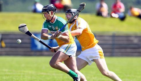 Antrim's Odhran McFadden with Offaly's Shane Dooley. Photograph: William Cherry/Inpho