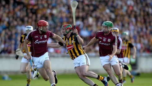 Kilkenny's Eoin Larkin with Iarla Tannian and David Burke of Galway. Photograph: Ryan Byrne/Inpho