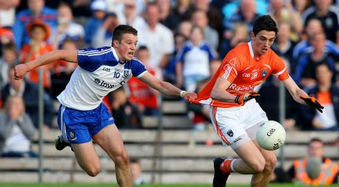 Armagh's Rory Grugan is fouled by Ryan Wylie of Monaghan during the final moments of the Ulster Football Senior Championship Semi-Final, St Tiernach's Park, Clones, Co Monaghan. Photograph: Photograph: Cathal Noonan/Inpho