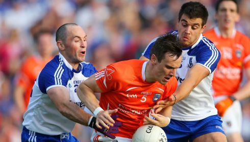 Armagh's Mark Shields with Stephen Gollogly and Drew Wylie of Monaghan.  Photograph: Cathal Noonan/Inpho