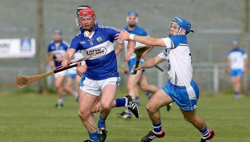 Joe Fitzpatrick of Laois with Colin Dunford of Waterford. Photograph: Donall Farmer/Inpho