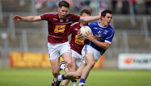 Cavan's Killian Brady and Callum McCormack of Westmeath in the All Ireland Senior Championship Qualifier Series Round 1B, Kingspan Breffni Park, Cavan. Photograph: Cathal Noonan/Inpho