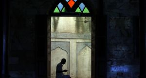 An Indian Muslim offers prayers inside a mosque during the first day of the fasting month of Ramadan in Mumbai yesterday. During Ramadan, Muslims refrain from eating, drinking and smoking from dawn to dusk. Photograph: Divyakant Solanki/EPA