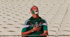 A distraught Mexican fan after their defeat at the hands of the Netherlands  in Fortaleza. Photograph: EPA
