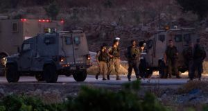 Israeli army and police by armoured vehicles in the West Bank village of Halhoul, north of Hebron, where reportedly the bodies of the three Israelis teenagers, missing and presumed kidnapped since June 12th, were discovered in a cave. Photograph: Jim Hollander/EPA