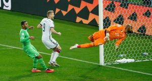 Germany's Andre Schurrle scores the first goal in extra-time against Algeria in Porto Alegre. Photograph: Leonhard Foeger/Reuters