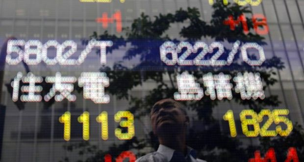Asian shares stay near highs, dollar hobbled by Fed