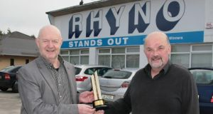Paudie O'Connor with his cousin Joe O'Connor of the Castleisland- based Rhyno Mills with the best retailer award they won in Brighton. Photograph: John Reidy