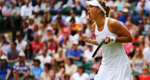 Angelique Kerber of Germany celebrates during her  fourth-round match against Maria Sharapova of Russia at Wimbledon. Photograph: Al Bello/Getty Images