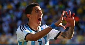 Angel di Maria celebrates scoring Argentina's  winning goal against Switzerland. Photo by Julian Finney/Getty Images