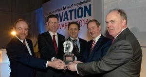 Taoiseach Enda Kenny presenting the Irish Times InterTradeIreland Innovation Award to Eoin Casey and Wayne Byrne of Oxymem, with Thomas Hunter McGowan (left), CEO InterTradeIreland, and Liam Kavanagh (right), managing director of The Irish Times, earlier this year. Photograph: Brenda Fitzsimons