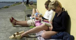 Read hot: summer reading at Bull Wall, Dollymount. Photograph: Cyril Byrne