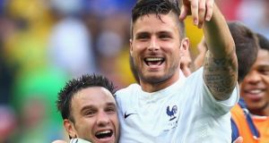 Mathieu Valbuena (left) celebrates with Olivier Giroud during the last-16 match against Nigeria at Estadio Nacional in Brasilia. Photograph: Jeff Gross/Getty Images