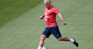 France's  head coach Didier Deschamps kicks a ball during a training session at the Botafogo soccer club's Santa Cruz stadium. Photograph: Charles Platiau/Reuters