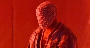 A masked Kanye West performs during his Yeezus tour. Photograph: Jason Merritt/Getty Images