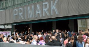 A large crowd gathers outside Berlin's second Primark store ahead of the opening by Taoiseach  Enda Kenny this morning. Photograph: Britta Pederson/EPA